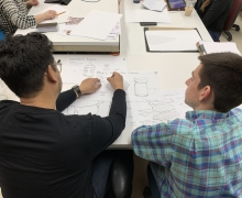 Jay Lee reviews sketches with student