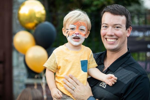 Dr. David English '04 '06 enjoys Homecoming 2018 with his son Harrison. Photo by Chase Reynolds