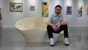 "Walter Mingledorff, a senior industrial design major specializing in furniture design, with his ""Best in Show"" lounger, ""I Lost my Multi-tool from Tupelo."" Photo submitted"